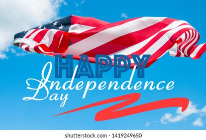 United States flag. Happy Independence day 4th of July. American flag in blue sky background.