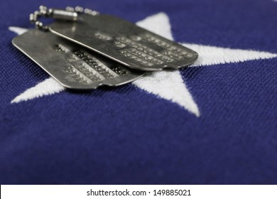 United States flag with military ID tags