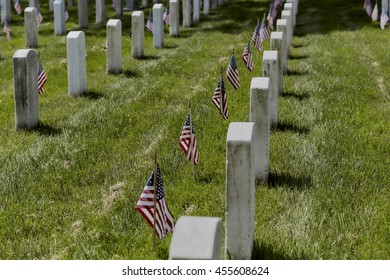 United States Flag on grave sites at Arlington National Cemetery on Memorial Day