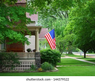 A United States Flag On An Old Porch