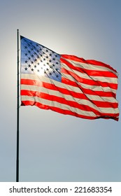 United States flag with sun as a backlight shining through