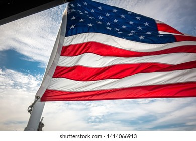 United States flaging flying in the wind