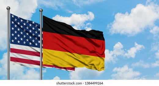 United States and Germany flag waving in the wind against white cloudy blue sky together. Diplomacy concept, international relations.