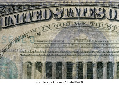 United States & In God we Trust text, highly magnified surface of used 5 dollars note with visible details of cotton fiber paper, with all flaws, watermarks and traces of usage.