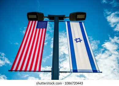 United States and Israeli flags on a lamp post