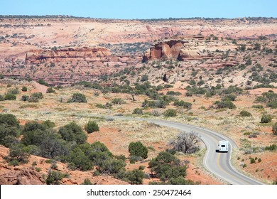 United States landscape - Canyonlands National Park in Utah. Island in the sky district - winding road with an RV.