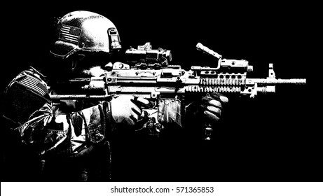 United states Marine Corps special operations command Marsoc raider with machine gun. Studio shot of Marine Special Operator black background