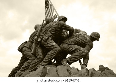 The United States Marine Corps War Memorial depicting the flag raising at Iwo Jima.  Black and white/sepia.