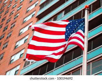 United States National flag in front of apartment building
