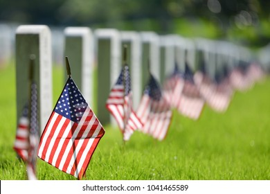 United States National flags and headstones in National cemetery - Circa Washington DC USA