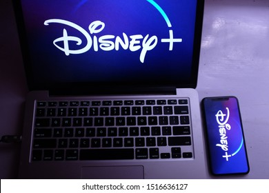 United States, New York. Saturday, September 28, 2019. Macbook and iphone 11 with the new Disney Plus service. Disney + will be an online video streaming subscription service.