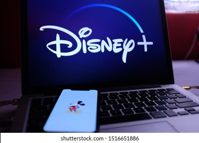 United States, New York. Saturday September 28, 2019. iphone 11 with Mickey Mouse image, in the background the new Disney Plus service. Disney + will be an online video streaming subscription service.