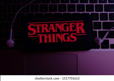 United States, New York. Sunday, September 29, 2019.Computer keyboard with the Iphone 11 pro with the Stranger Things logo. Stranger Things is an American web series of suspense and science fiction.