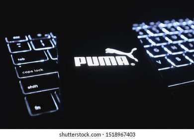United States New York. Tuesday, October 1, 2019: Computer keyboard and iphone 11 pro with the Puma logo. Puma SE is a German manufacturer of accessories, clothing and sports shoes.