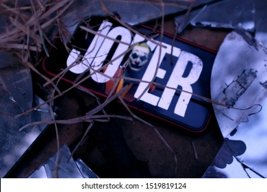 United States New York. Tuesday, October 1, 2019, broken glass and Iphone 11 pro with the logo of the Jocker 2019 movie. Joker is an upcoming American criminal film distributed by Warner Bros.