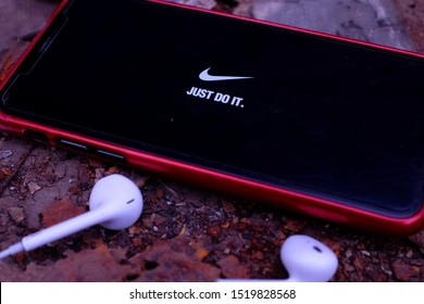 United States New York. Tuesday, October 1, 2019. EarPods and Iphone 11 pro with the Nike Just do it logo. Nike, Inc. is an American multinational company dedicated to the design of sporting goods amo