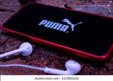 United States New York. Tuesday, October 1, 2019. Earpods and Iphone 11 pro with the Puma logo.Puma SE is a company [Italy | Italian]] manufacturer of accessories, clothing and sports shoes.
