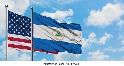 United States and Nicaragua flag waving in the wind against white cloudy blue sky together. Diplomacy concept, international relations.