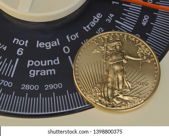 """United States One Ounce Gold Eagle (50 Dollar Piece) With Obverse Showing Placed Over An Analog Scale Display With The Words """"Not Legal For Trade"""""""