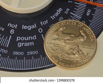 """United States One Ounce Gold Eagle (50 Dollar Piece) With Reverse Showing Placed Over An Analog Scale Display With The Words """"Not Legal For Trade"""""""