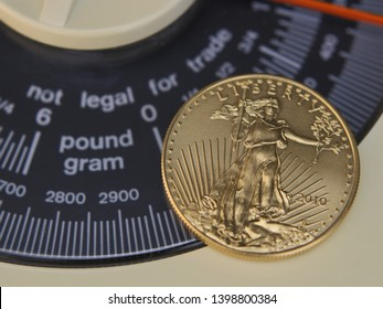 """United States One Ounce Gold Eagle (50 Dollar Piece) With Obverse Showing Placed Over An Analog Scale Display With The Words """"Not Legal For Trade"""" Blurred"""