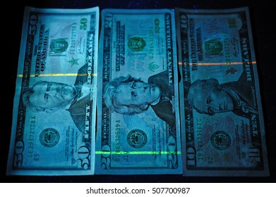 United States paper currency under UV light.