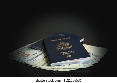 United States passport on top of a fortune in US dollar bills as concept for citizenship or travel