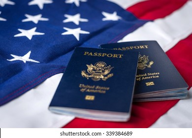 United States Passports on top of an American Flag