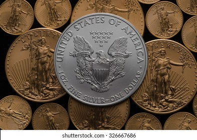 United States Silver Eagle Coin on bed of American Gold Eagles