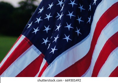 United States US Flag in Backyard at Sunset