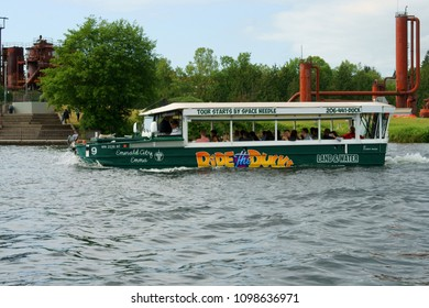 """UNITED STATES, WA, SEATTLE - MAY 21, 2018: Ride Ducks, wonderful tourist attraction. It makes use of over 90 amphibious vehicles (nicknamed """"ducks"""") to provide tours of cities by boat and by land"""