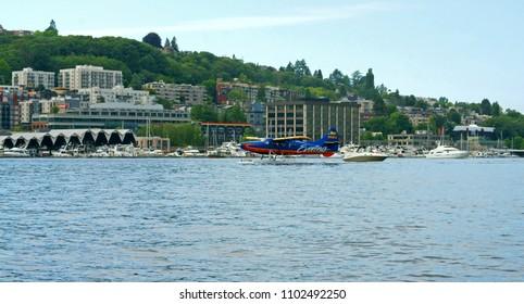 UNITED STATES, WA, SEATTLE - MAY 21, 2018: Floatplane taking off in Lake Union
