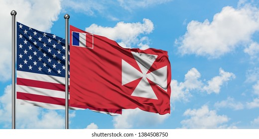 United States and Wallis And Futuna flag waving in the wind against white cloudy blue sky together. Diplomacy concept, international relations.