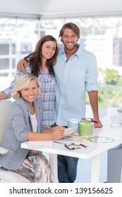 United team of interior designer standing together at desk in bright modern office