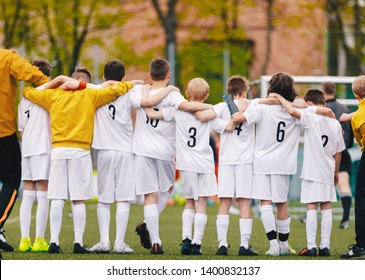 United Youth Sports Team. Football Soccer Teen Players Standing Together with Coach During Penalty Kicks. Boys in White Soccer Jersey Sportswear