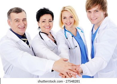 unity of four happy successful doctors - isolated on white background