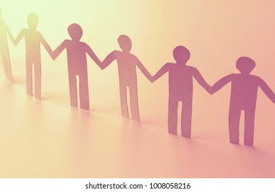 unity of paper human team work symbol