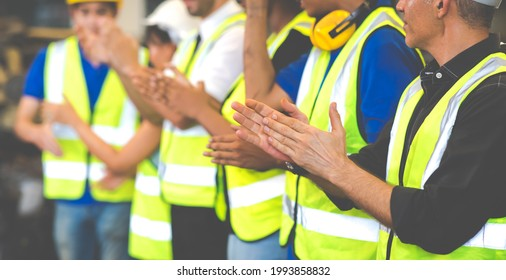 Unity and teamwork concept. team standing hands together. Professional Mechanical Engineer team Working at Second-hand spare parts of old car parts warehouse store. Celebrate clapping