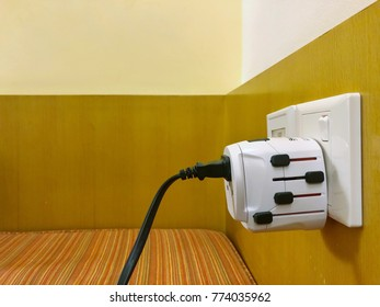 Universal adapter plug. International electrical adapter plugs. Can use around the world. Copy space.