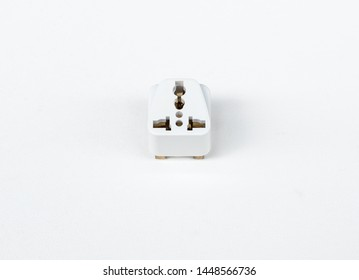Universal adapter plug on the white canvas for traveler to use in the worldwide.