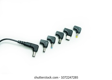 Universal Adaptor charger for wlectronic device such as laptop and drone isolated over white background.Multi-head universal adaptor for charger with different size and shape .Selective Focus shot.