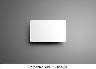 Universal blank mockup  one bank (gift) card with shadows on a gray background. Top of view.