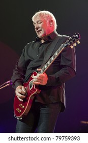 UNIVERSAL CITY, CA - JUNE 22: Alex Lifeson of the rock band Rush hits the stage for part of their Time Machine Tour at the Gibson Amphitheater in Universal City, CA on June 22, 2011.