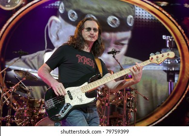 UNIVERSAL CITY, CA - JUNE 22: Geddy Lee of the rock band Rush hits the stage for part of their Time Machine Tour at the Gibson Amphitheater in Universal City, CA on June 22, 2011.
