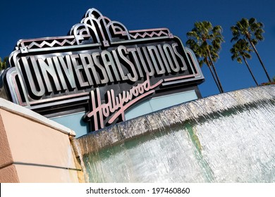 """UNIVERSAL CITY, CA - JUNE 4, 2014: The Universal Studios Hollywood sign greeting visitors outside the amusement park. It's official marketing headline is """"The Entertainment Capital of LA""""."""