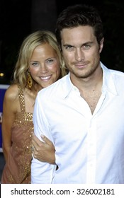 """UNIVERSAL CITY, CALIFORNIA. August 2, 2005. Erin Bartlett and Oliver Hudson attend the """"The Skeleton Key"""" Los Angeles Premiere at the Universal Studios Cinema in Hollywood, California ."""