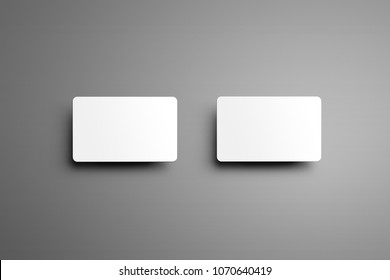 Universal mockup of a  two  bank gift cards with shadows isolated on a gray background. Top of view.