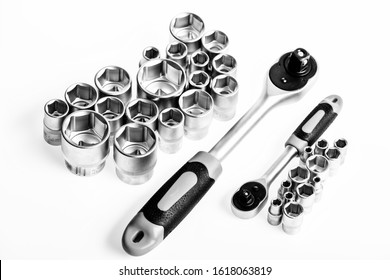 Universal socket set white background isolated. Crafts and repair. Knob for socket wrench nut ratchet close up. Steel made no skid threaded handle without slipping. Ratchet wrench. Ratchet tool.