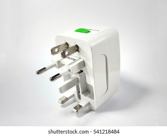Universal traveler adapter plug isolated on white background