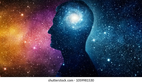 The universe within. Silhouette of a man inside the universe. The concept on scientific and philosophical topics.  Elements of this image furnished by NASA.